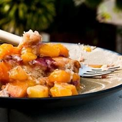 Fresh Fruit Cobbler Recipe - Slices of sugared fresh fruit - peaches, pears, plums, and cherries - are piled into a large casserole dish and covered with a sweet batter. Thirty minutes later, the cobbler emerges bubbling, fragrant, and golden brown.