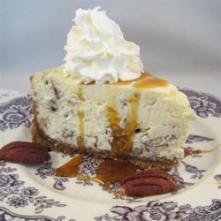 Butter Pecan Cheesecake Recipe - A buttery pecan crust under a pecan cheesecake produces a crowd-pleasing butter pecan cheesecake perfect for Thanksgiving.