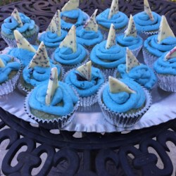 Shark Cupcakes Recipe - These berry-flavored cupcakes are dyed blue in homage to shark week.