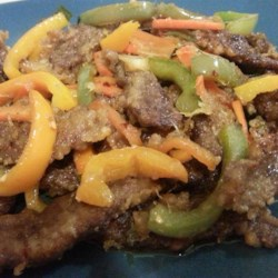 Crispy Ginger Beef Recipe - Ginger beef, the Canadian takeout favorite, is even better made at home. Beef strips are wok-fried with a crispy coating, colorful veggies, and a sweet dark sauce.
