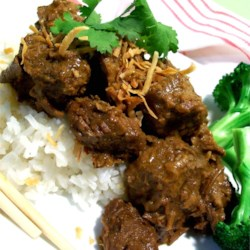 Malaysian Beef Rendang Recipe - First browned in a shallot, ginger, and lemon grass paste and a mixture of freshly ground coriander, cumin, and nutmeg, the bite-size pieces of beef are cooked in coconut milk until tender.