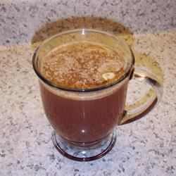 Hot Buttered Apple Cider Recipe - Hot apple cider sweetened with maple syrup and topped with butter and spices. A wonderful drink on a cold night or morning. You will have spiced butter left over for your next batch!