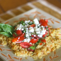 Orzo with Tomatoes, Basil, and Gorgonzola Recipe - Toasted orzo pasta is simmered with garlic, then tossed with fresh cherry tomatoes, basil, and gorgonzola cheese in this delicious Italian-inspired side dish.