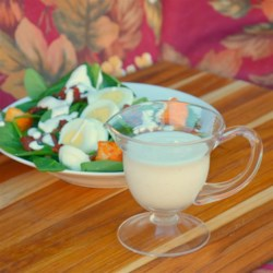 Spinach Salad Dressing Recipe - Cream, onion, dry mustard, and vinegar come together with a touch of sugar in this easy spinach salad dressing recipe.