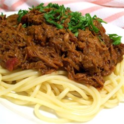 Italian Gravy Recipe - Italian Gravy is a homemade tomato meat sauce for spaghetti. This recipe uses pork shoulder and Italian herbs, and is simmered for 5 to 6 hours.