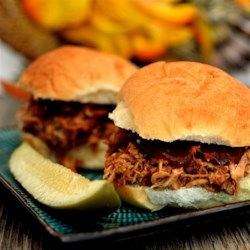 Missouri Miner Pulled Pork Recipe - You can easily feed a crowd with this barbeque favorite, made with pork shoulder roast and boneless pork ribs cooked in a slow cooker.