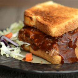 Simple and Yummy Pulled Pork Recipe - If you have a pressure cooker, you can turn full pork butt, some root beer, and barbeque sauce into a pile of pulled pork in about an hour.