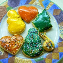Egg Yolk Tempera Recipe - This makes a shiny gloss finish on most any cookie. It works best on light-colored cookies, like sugar cookie cutouts.  Depending on the color you are going for, you will probably need between 2 and 8 drops of food coloring.
