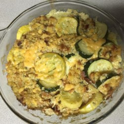 Squash Stuffing Recipe - Stuffing mix is augmented with fresh yellow squash (or zucchini) and melted cheese. This is a great holiday side dish, but it's also a nice treat on a cool evening at the end of summer.