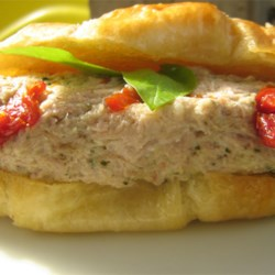 Pesto Tuna Salad with Sun-Dried Tomatoes Recipe - Pesto and sun-dried tomatoes make a splash in this excitingly different tuna salad. Serve on bread or lettuce.