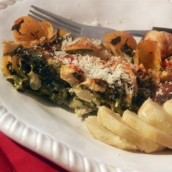 Cheesy Spinach Casserole Recipe - A wonderful dish for parties or for home.  This dish has a strong spinach and Monterey Jack cheese flavor, with a hint of artichoke and onion.