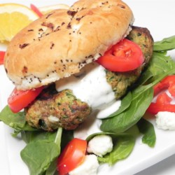 Greek Turkey Burgers Recipe - Ground turkey, feta cheese, and Greek salad dressing are mixed together in these Greek turkey burgers perfect for summer grilling.