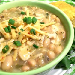 Carol's Chicken Chili Recipe - Chicken breast, onion, chile peppers and beans make for great white chili sustenance! Here is a good recipe for those cold nights. Serve with some crusty French bread and a salad. Season to your own taste (some might like it spicier.)