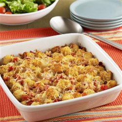 Cheesy Taco Potato Puff Casserole Recipe - A side dish recipe for cheesy taco bake casserole with potato puffs, zesty tomatoes and taco seasoning topped with shredded cheese.