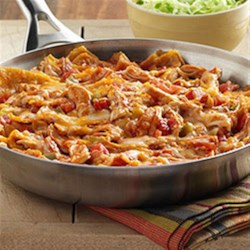 Chicken Enchilada Skillet Recipe - The flavor of an enchilada recipe made quickly in a skillet with torn corn tortillas, cooked chicken, zesty tomatoes and sauce with cheese.
