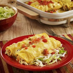 Chicken Enchiladas Verdes from RO*TEL Recipe - Corn tortillas filled with chicken, cheese and green enchilada sauce with some zesty tomatoes on top for easy chicken and cheese enchiladas.