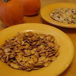 Spicy Roasted Pumpkin Seeds Recipe - Roasted pumpkin seeds are seasoned with a hint of spice and garlic in this easy fall recipe.