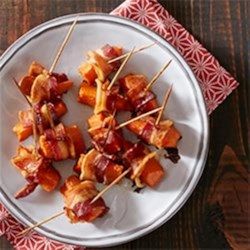 Bacon Wrapped Sweet Potato Bites Recipe - As if you needed another reason to love bacon. Don't miss this sweet and savory appetizer from Russ Crandall of The Domestic Man.