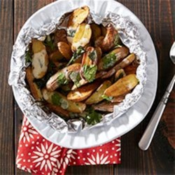 Cheesy Oven Roasted Fingerling Fries Recipe - Every table deserves to try this finger-licking-good appetizer from Gaby Dalkin of What's Gaby Cooking.