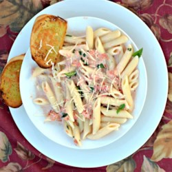 Quick Tomato Basil Cream Sauce Recipe - This simple pasta sauce is a mixture of heavy whipping cream, fresh basil, and canned diced tomatoes with garlic and onion.