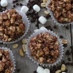 Rocky Road Popcorn Balls Recipe - Popcorn balls are an easy homemade treat that make great party favors. These are studded with mini marshmallows, chocolate chips, and peanuts.