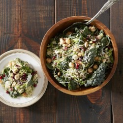 Kale and Brussels Slaw with Quinoa Recipe - Chopped kale and thinly sliced Brussels sprouts are tossed with sweet-spicy hazelnuts, cooked quinoa, and pomegranate seeds in a lemon-maple vinaigrette.