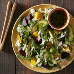 Beet and Fennel Salad with Goat Cheese Recipe - Red and golden beets, fennel slices, crumbled goat cheese, and avocado slices drizzled with basil vinaigrette make a delicious salad.