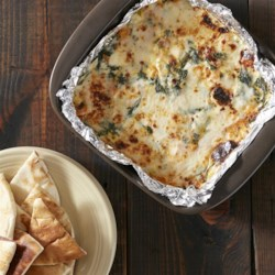 Roasted Butternut Squash and Spinach Dip Recipe - Four different cheeses, roasted squash, spinach, and maple bacon combine for this autumn twist on a classic dip.