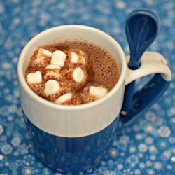 Hot Chocolate, Slim Recipe - Enjoy this hot chocolate made with coconut water, dark chocolate, and cocoa topped with marshmallows.
