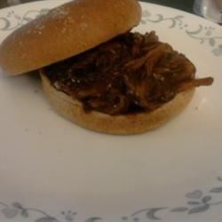 Slow Cooker Barbequed Pork for Sandwiches Recipe - This is always ready for tailgating and barbecues! I serve either on toasted rolls or with a starch like rice and a vegetable. Try using two different bottles of barbeque sauce: one smoky and sweet; one spicy.