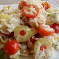 Tracy's Tomato Artichoke Rice Salad Recipe - This is a great cold salad dish with little preparation time. It has a Greek flair to it and is delicious. I always come home with an empty dish. The key to it is using fresh tomatoes if you have them. Hope you enjoy it as much as we have.