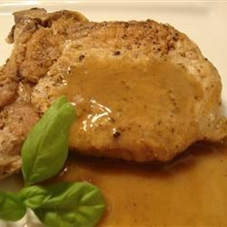 Pork Chops with Vinegar Recipe - Add rich flavor to pan-cooked boneless loin pork chops with an easy sauce of meat juices, butter, flour, and the surprise of salty anchovies.