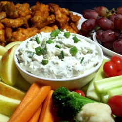 Blue Cheese Dip II Recipe - Blue cheese crumbles kindly lend their distinctive flavor to this simple, smooth mixture. Serve with corn chips. This dip tastes better the longer it chills before serving.