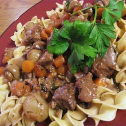 Beef Bourguignon II Recipe - Stewing meat is browned and braised in red wine with carrots, garlic,  onions, and herbs. Mushrooms and more onions are added for the last half hour of cooking.