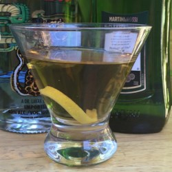 Tequini Recipe - Vermouth, orange bitters and lemon zest begin a martini, transformed into a Tequini by....tequila!