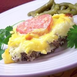 Herald's Impossibly Easy Cheeseburger Pie Recipe - Ground beef combines with cheddar cheese and fresh tomato slices. It is topped with a crust made from buttermilk baking mix.