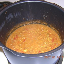 Apricot Lentil Soup Recipe - This pureed soup is made with red lentils, dried apricots and tomatoes cooked in chicken broth with cumin and thyme.  The addition of fresh lemon juice prior to serving intensifies the flavors.