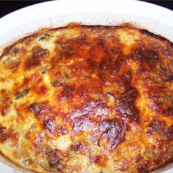 Christmas Brunch Casserole Recipe - Prepare this casserole, loaded with bacon, fresh mushrooms, hash browns, onions, and cheese on Christmas Eve. Pop it in the oven first thing on Christmas morning.
