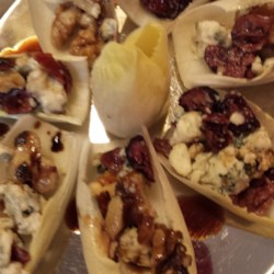 Easy Endive, Cranberry, Walnut Appetizers Recipe - Quick and easy to prepare, this recipe yields a delicious appetizer using blue cheese, sweetened dried cranberries, and glazed walnuts over endive.