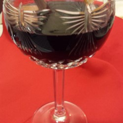 Caroling Wine Recipe - A delightful winter concoction of fruit juice and red wine - spiced and served hot with a cinnamon stick.