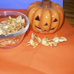 Sweet Spicy Pumpkin Seeds  Recipe - Pumpkin seeds saved from your Halloween pumpkin are toasted and coated with a sweet, spicy cinnamon and chili seasoning.