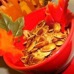 Caramelized Spicy Pumpkin Seeds Recipe - Pumpkin seeds from your Halloween pumpkin make a crunchy, sweet and spicy snack when roasted and coated with sugar, cinnamon, ginger, cumin, and a pinch of cayenne pepper.