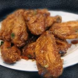 Kowloon's Chinese Chicken Wings Recipe - Gin is the secret ingredient in the soy-ginger marinade for this appetizer.