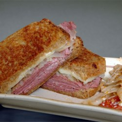 Reuben Sandwich I Recipe - A grilled Reuben sandwich made with pastrami, sauerkraut, Swiss cheese and 1000 island dressing on rye bread.