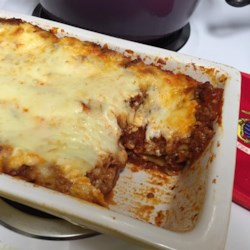 Italian Sausage Lasagna Recipe - Italian sausage-based tomato sauce and well-seasoned mozzarella cheese are baked into this filling lasagna dish perfect for weeknights or entertaining.