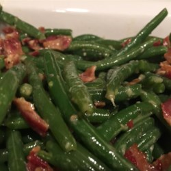 Bacon-Garlic Green Beans Recipe - Bacon and garlic are the secret ingredients in this green bean dish that's sure to become a Thanksgiving favorite, or even on your weeknight dinner table.