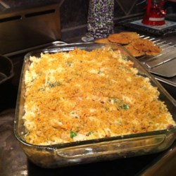 Garlic Chicken Mac and Cheese Recipe - This recipe yields a big baking dish filled with a hearty macaroni and cheese dish jazzed up with garlic and chicken.
