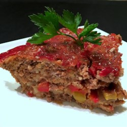 Onion- and Pepper-Stuffed Meatloaf Recipe - Ever get bored with meatloaf? Try this twist on a classic recipe that stuffs the meatloaf with onions and peppers, creating delicious results.