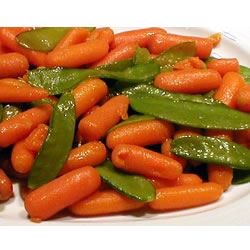 Honey Glazed Pea Pods and Carrots Recipe - A touch of golden honey flavors these tender pea pods mixed with sweet carrots.