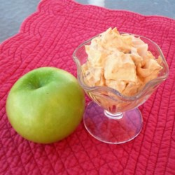 Easy Caramel Apple Salad Recipe - Butterscotch pudding, apples, peanuts, and whipped topping are folded together into an easy caramel apple salad.